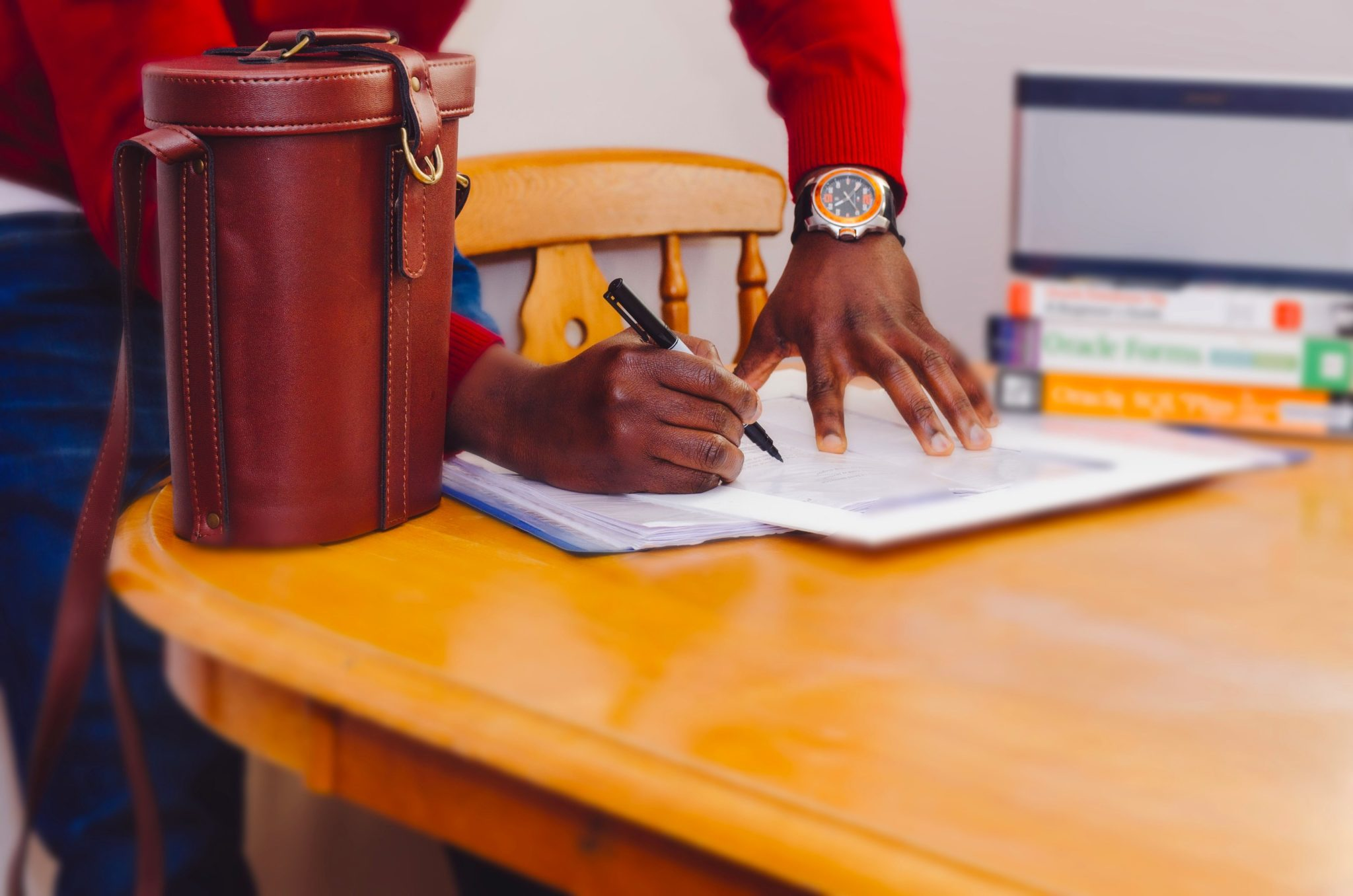 man signing a document and closing a deal