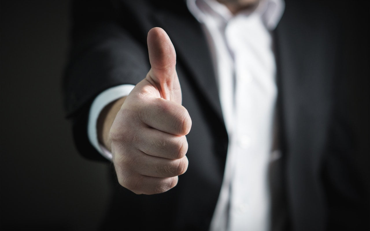 Business man giving a thumbs up for es Performance Inventive Funds(SPIFs)
