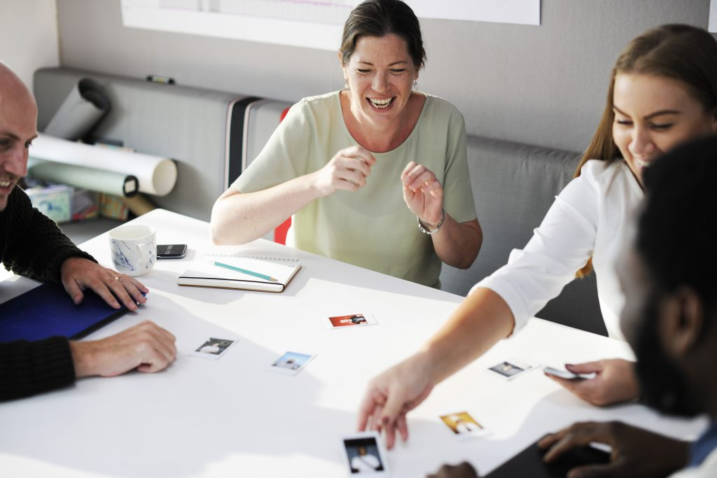 Group of people at working discussing and laughing together