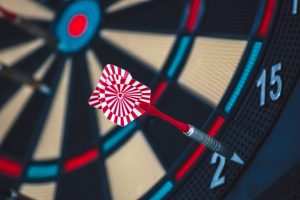 Dart on a dartboard missing the target