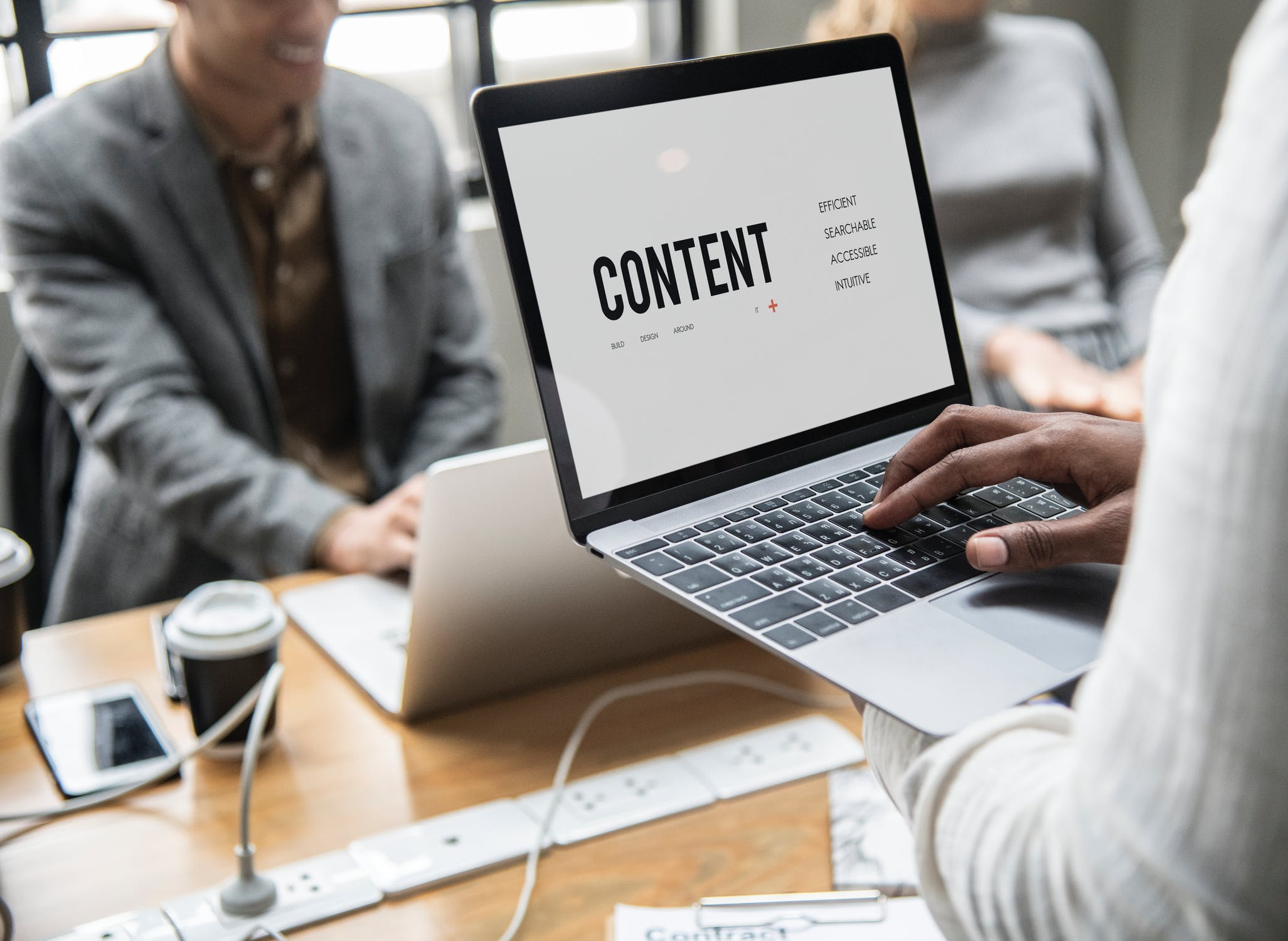 person on laptop displaying the words content
