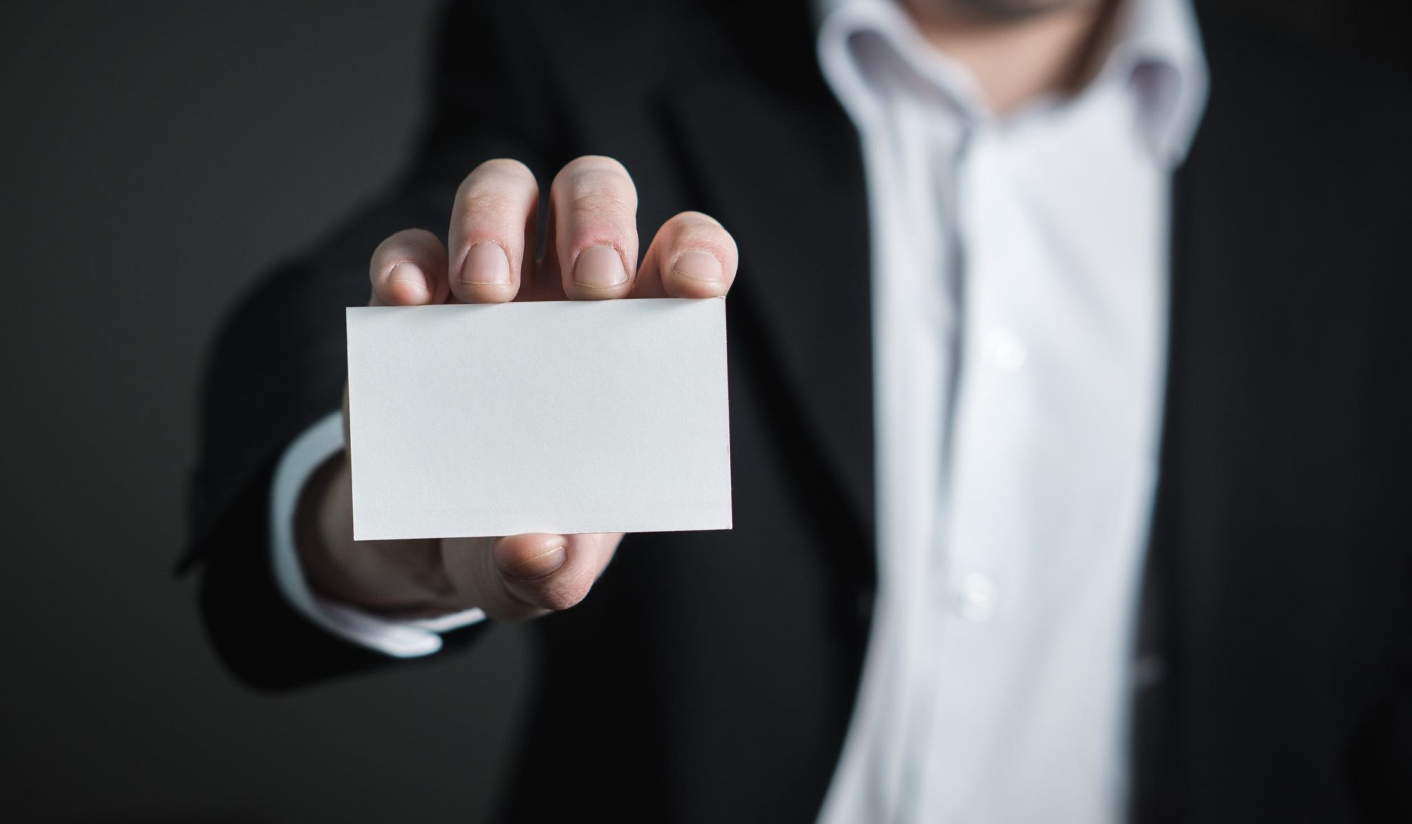 Business man holding blank notecard